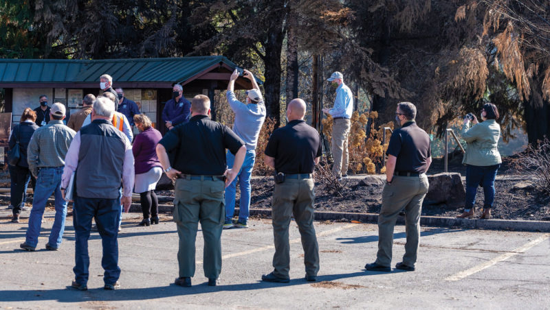 A group of federal, state, and county leaders met in Lyons to hear Consumers Power CEO Roman Gillen discuss the co-op's response to the wildfires.