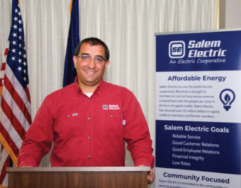 A man standing behind a podium in front of the American flag. Salem Electric, An Electric Cooperative. Affordable energy. Salem Electric is a not-for-profit electric cooperative. Electricity is brought to members at cost and any excess revenue is shared back with the people we serve in the form of capital credits. Salem Electric has returned over 30 million dollars in capital credits to members and former members. Salem Electric Goals. Reliable service, good customer relations, good employee relations, financial integrity, low rates. Community Focused. Salem Electric is committed to the communities we serve by providing