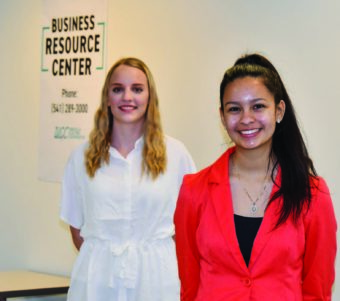 Two young girls standing. Business Resource Center. Phone 341-289-3000