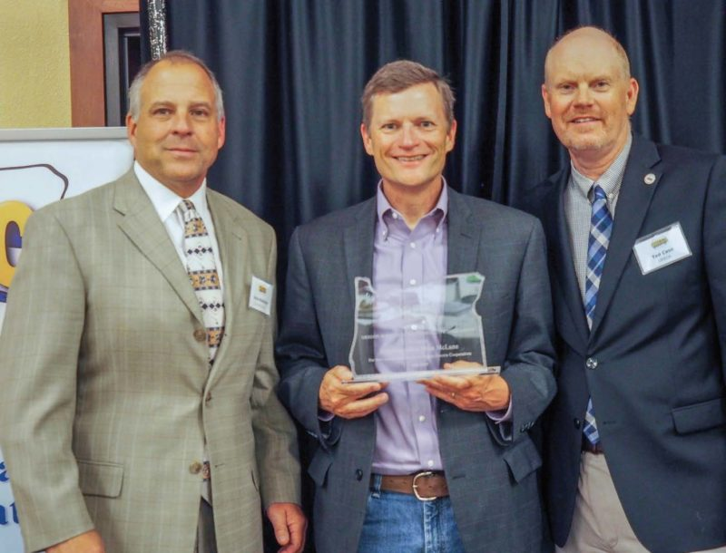 Central Electric CEO Dave Markham, left, and ORECA Director Ted Case, right, presented Rep. Mike McLane with the ORECA Lifetime Achievement Award.