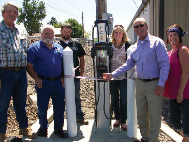 Dedicating the electric vehicle charging station in Condon are, from left, Condon Mayor Jim Hassing, Columbia Basin Electric Cooperative Director Roy Carlson, CBEC staff member Josh Coiner, CBEC staff member Debbie Lankford, Gilliam County Judge Steve Shaffer and Condon Chamber of Commerce Executive Director K'Lynn Lane. Photos by Tommy Wolff