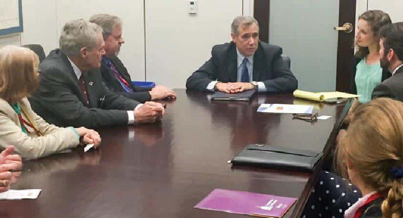 Electric co-op leaders informed Sen. Jeff Merkley, center, that Oregon's plan to spill more water over the dams could cost consumers more than $100 a year each.