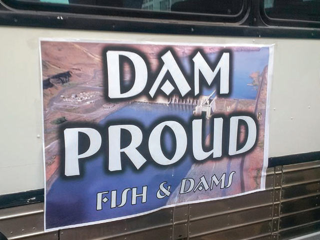 The sign on a Northwest RiverPartners bus tells the whole story at the NEPA meeting in Portland. Photo by Norm Semanko