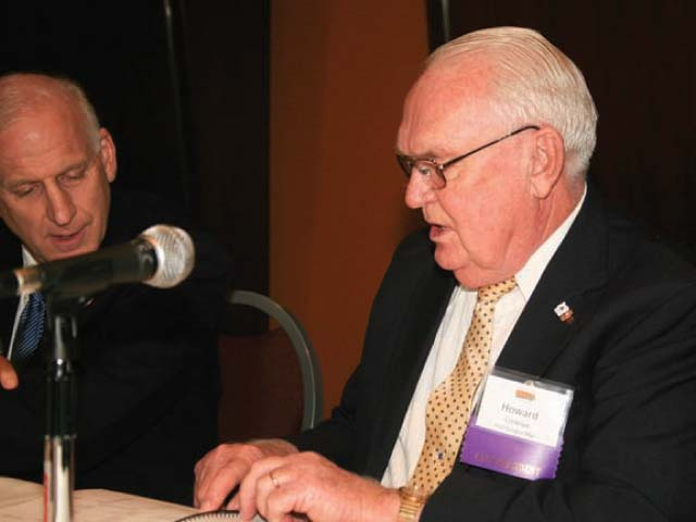 Mark Glaess, left, former ORECA executive director, and Howard Crinklaw, former Douglas Electric general manager, participate in a panel at ORECA's 2012 annual meeting.