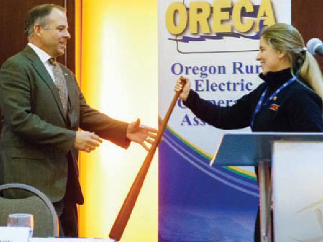 Central Electric CEO Dave Markham accepts the ACRE Power Hitter Award from ACRE Chairwoman J. Ingrid Kessler.