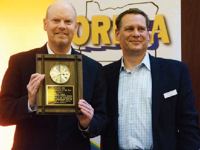 Executive Director Ted Case, left, is presented with Ruralite's Communicator of the Year Award by CEO Mike Shepard.