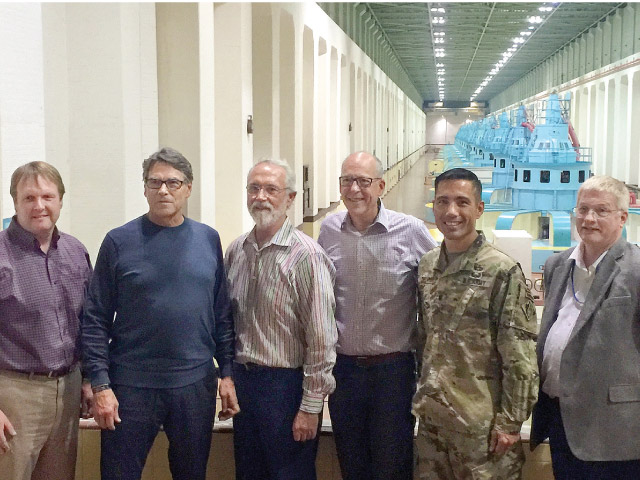 Perry's visit included a tour of McNary's powerhouse. From left are BPA Administrator Elliot Mainzer; Perry; Newhouse; Walden; Lt. Col. Damon A. Delarosa, U.S. Army Corps of Engineers; and Rick Werner, chief of operations, U.S. Army Corps of Engineers.